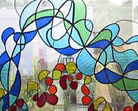 glas in lood in staal venster - Lia Koster- uitgevoerd door Segno 'd Arte